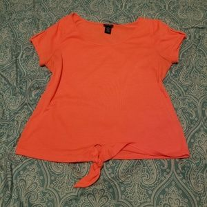 Bright orange crop top runs small